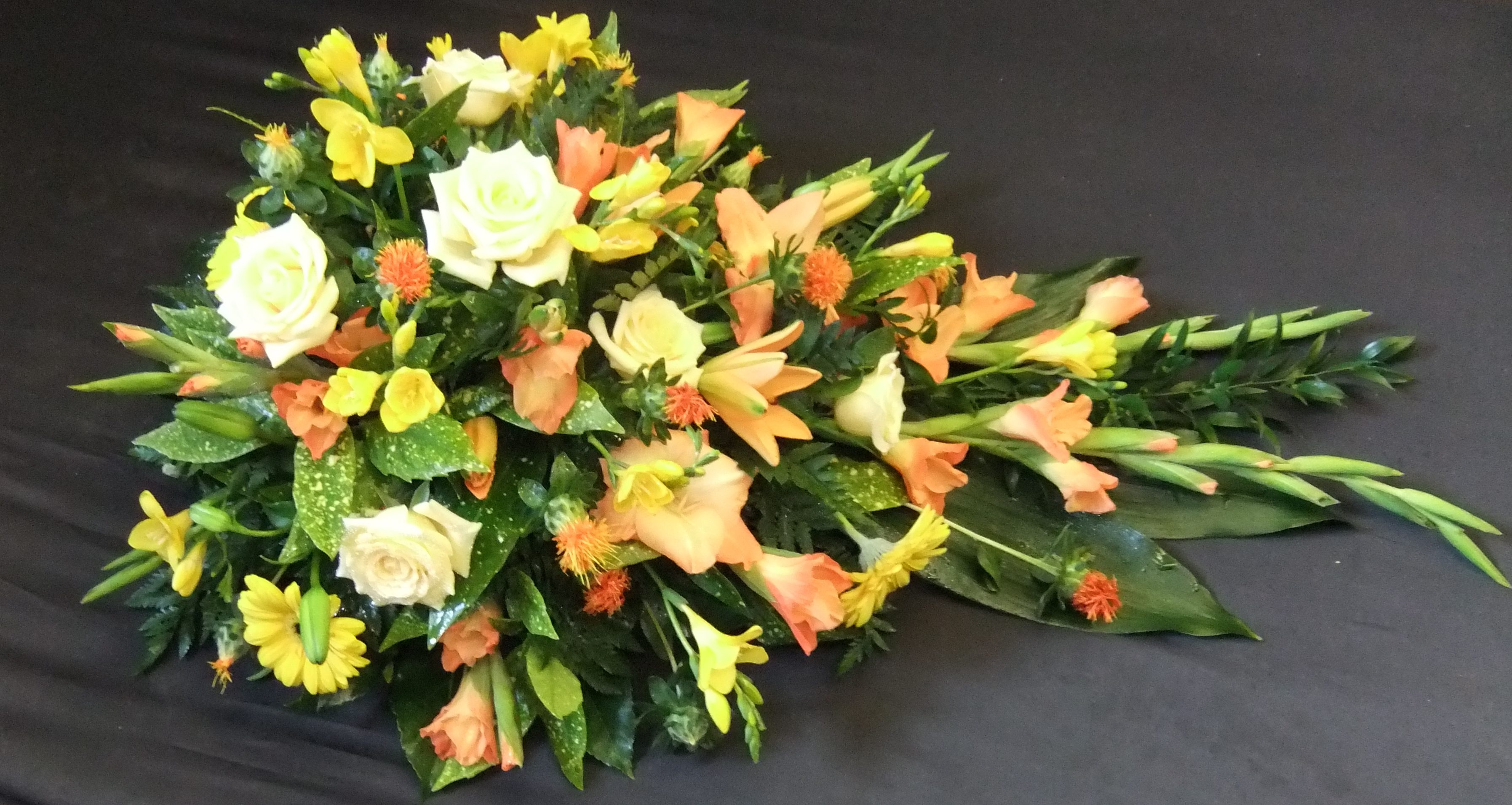 Funeral flower pictures john thomas florist single ended spray in orange yellow and cream izmirmasajfo